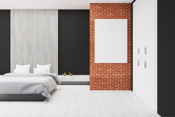 Brick and wooden bedroom, poster, armchair