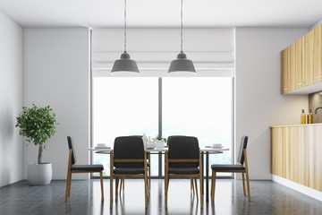 White dining room, black chairs