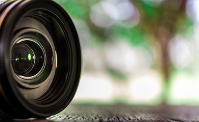 Close up front lens with green and natural bogeh background