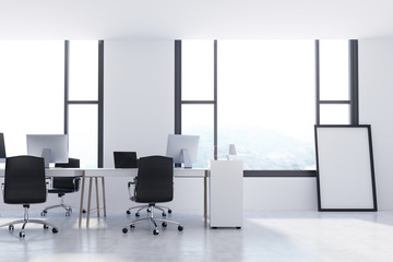 White office with a framed poster