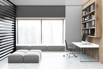 Gray and wooden home office interior