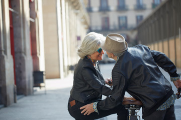 Cool senior couple kissing in the street