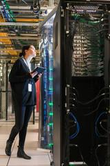Server room technician gazes up  at a server