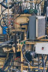 Semi-auto machines in metalworking workshop