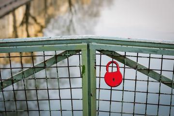 Red lock on a bridge over the Canal Saint-Martin, Paris