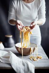 Woman holding pumpkin pasta