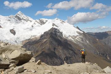 Mountain climber admiring a beautiful scenery in Cordillera Blanca