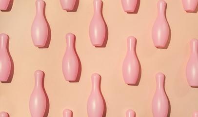 Pink bowling pins arranged.