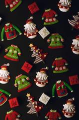 Christmas decorations on black background.