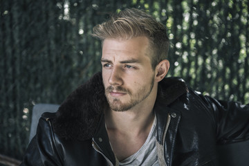 Portrait of Man in Leather Bomber Jacket with Shearling Collar