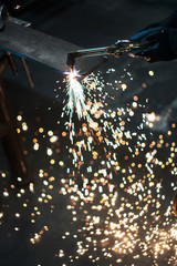 Sparks fly from oxy acetylene welding