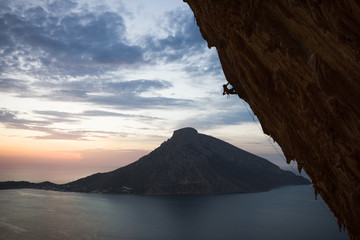 Rock climber climbing a steep overhang
