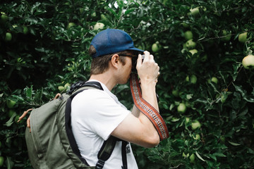 Man taking photo of apple tree