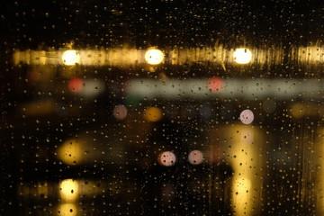 Rain drops on the window of an airplane.