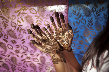 Teenage girl decorated with Mehendi in hands