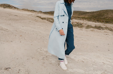 woman with blue trench coat outdoors
