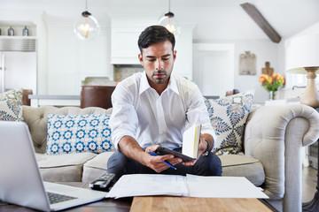 Hispanic businessman working at home