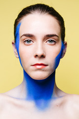 Female model with painted neck and face