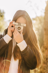 Young Woman Using a Retro Camera