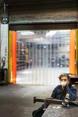 Portrait of female factory worker
