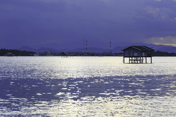 the small fishing house in the sea at the fish farm in Thailand