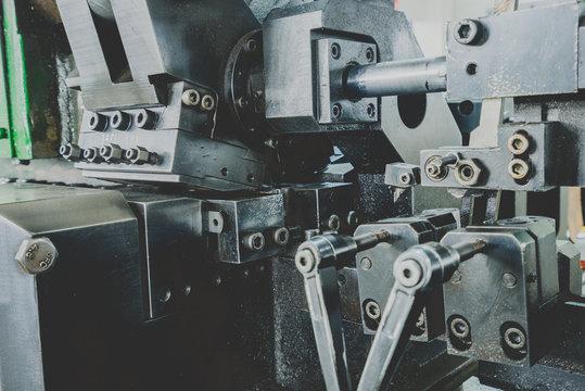 closeup of Semi-auto machines in metalworking workshop