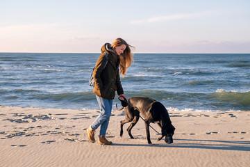 Pretty woman walking her dog