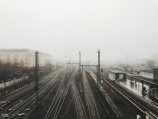 Berlin Rail Tracks and Station on Foggy Winter Day
