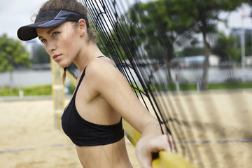 Woman and volleyball net