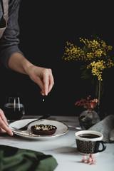 Woman is making chocolate tart