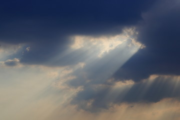 sky with clouds and dramatic god light.