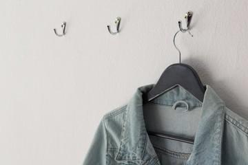 Denim jacket hanging on hook