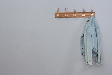 Denim jacket hanging on hook