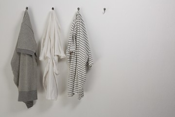 Various t shirts hanging on hook
