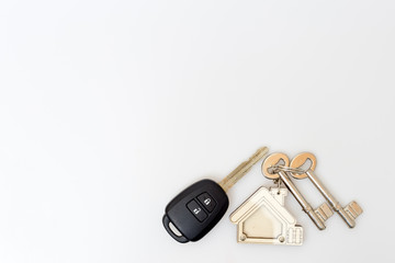 Car and house keys on table. Concept of success.