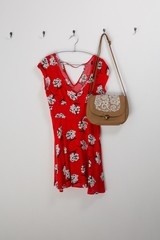 Red dress and bag hanging on hook
