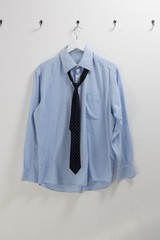 Shirt with tie hanging on hook