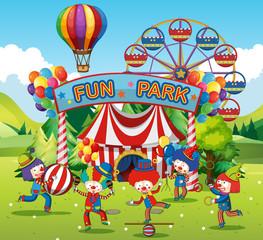 Happy clowns in fun park