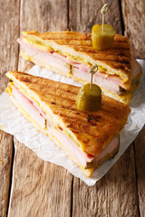 Delicious hot Cuban sandwich close-up on the table. vertical