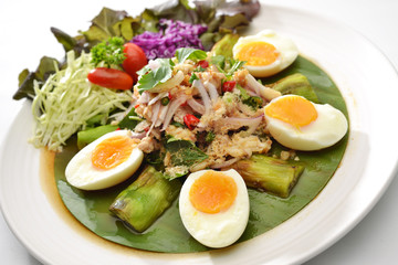 Thai Hot Spicy Salad eggplant and half boiled egg see yolk eat with many vegetable and Chilli
