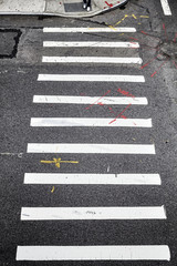 Pedestrian crossing in New York City from above, conceptual background picture.