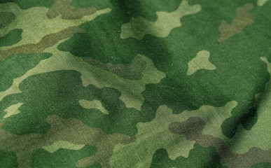Green and brown color military uniform pattern with blur effect.