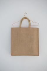 Close-up of jute bag hanging on wall