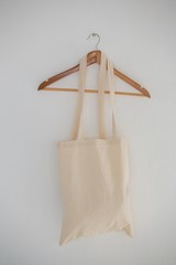 Close-up of grocery bag hanging on wall