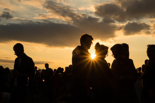 People at festival during summer sunset