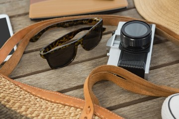Travel accessories on wooden plank