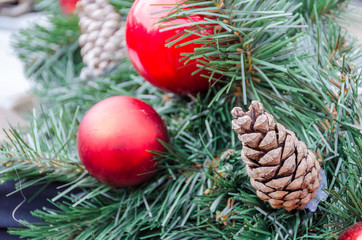 Christmas decoration baubles with branches of fir tree.