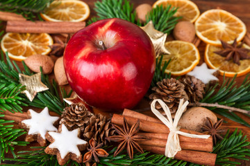 Christmas spices with Red Apple decorated over old wooden background