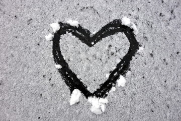 Hand drawn heart shape in snow