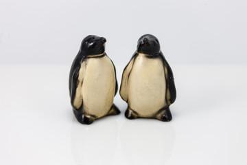two eyeless penguin salt and pepper shakers
